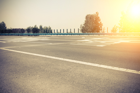 the transverse: Asphalt road in the morning Stock Photo