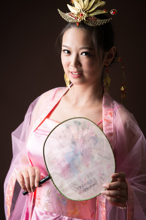 Chinese woman wearing traditional costumes Фото со стока