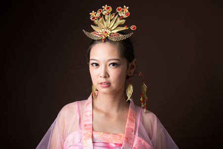 Chinese woman wearing traditional costumes Stok Fotoğraf