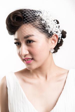Chinese bride, white background studio shoot