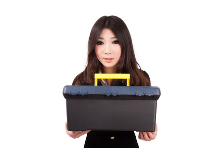 A Chinese girl holding a toolbox
