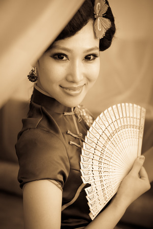 Woman wearing a cheongsam, Chinese classical costumes