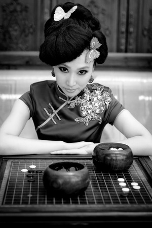Woman wearing a cheongsam, Chinese classical costumes,In chess