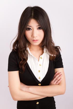 A beautiful Asian staff with business attire Фото со стока