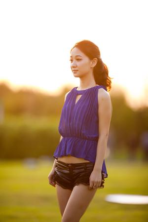 Asian beauty in green background Фото со стока