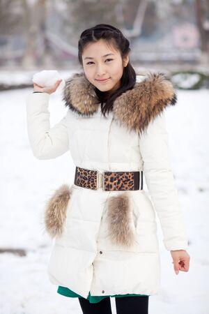 Asian girl holding snow photo