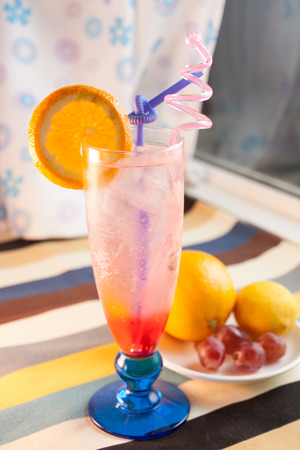 Lemonade, ice and lemon in the cup photo