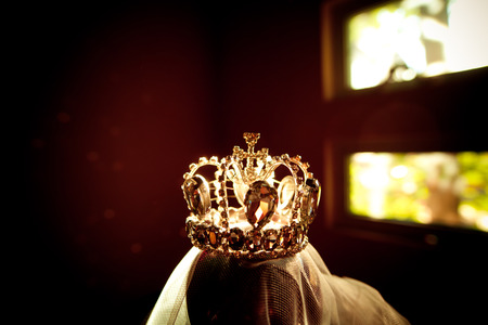 A crown studded with diamonds, sparkling Stock Photo