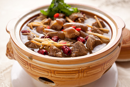 Chinese food, beef stew contains ginseng, medlar, angelica many herbs Фото со стока