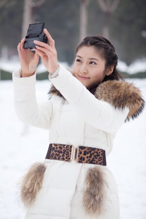 A pretty chinese girl, during the filming of her own