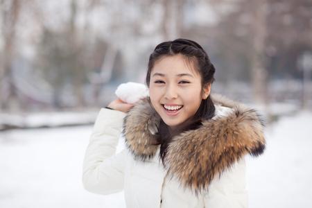 Snowball in an Asian girl hand