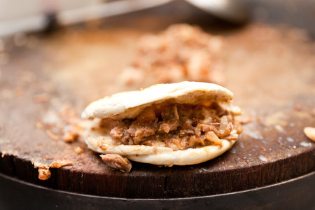 rou: Pork belly caramelised and braised in soy sauce with star anise, cinnamon and chilies inside a steamed bun  Stock Photo