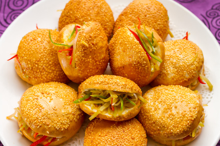 Chinese food: clay oven rolls and pickles photo