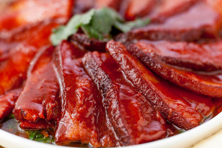 belly pepper: Chinese red-cooked pork belly on a white background