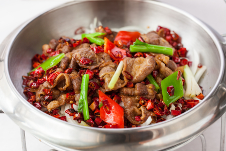 Chinese dishes: fried pork with chili