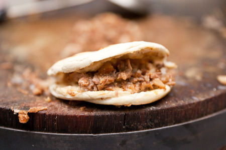 rou: Pork belly caramelised and braised in soy sauce with star anise, cinnamon and chilies inside a steamed bun