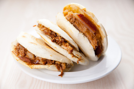 Pork belly caramelised and braised in soy sauce with star anise, cinnamon and chilies inside a steamed bun