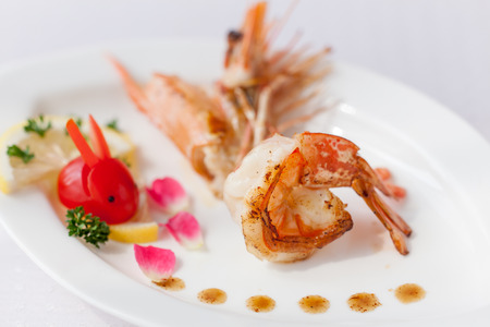 Fried prawn, put in the dish, and tomatoes photo