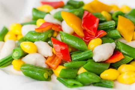 Close shot salad, vegetables and seafood photo