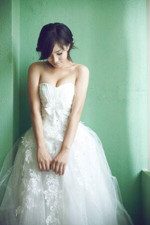 Asian bride wore a white wedding dress