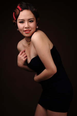 Asian girl dressed in black evening photo