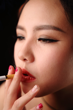 sexy girl smoking: Asian girl dressed in black evening