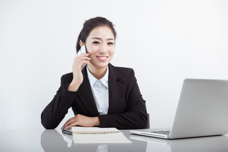 Asian business woman talking on the phone