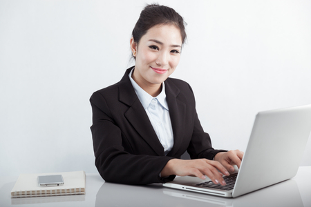 Asian business woman using laptop at work Stock Photo - 88535383