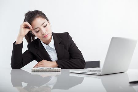 Asian businesswoman resting on the desk Фото со стока