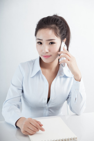 Asian business woman using mobile phone Stock Photo - 88535386