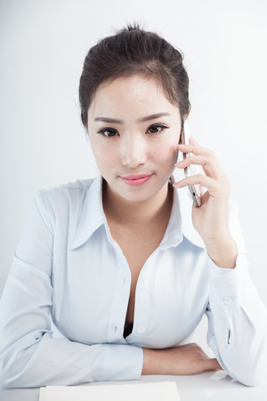 Asian business woman using mobile phone Stock Photo - 88535387