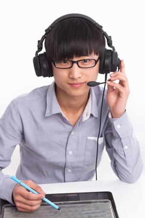 A Chinese male operator Фото со стока