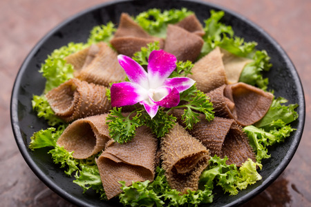 tripe: raw tripe with vegetables ready to be cooked,Sichuan Hot pot dishes Stock Photo