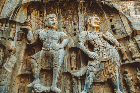 Luoyang Longmen Grottoes, ancient Chinese Buddha Stock Photo