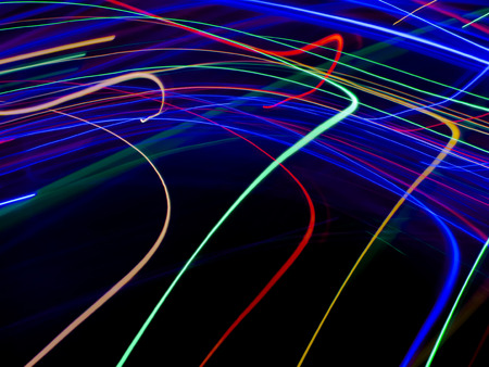 Abstract light paint art with colorful lights backdrop high speed motion in dark and shadow. Include Red Blue Green Gold Orange long lines pattern. This drawing shape loop photo is luxury neon design.