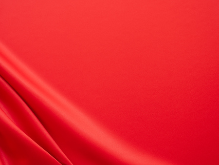 Beautiful smooth elegant wavy hot red satin silk luxury cloth fabric texture, abstract background design. Wallpaper, banner or card with copy space. 免版税图像