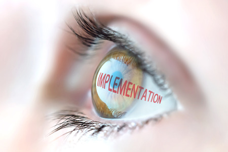 implementation: Implementation reflection in eye. Stock Photo