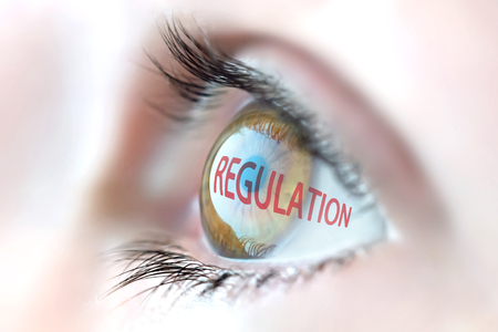 prohibitive: Regulation reflection in eye. Stock Photo