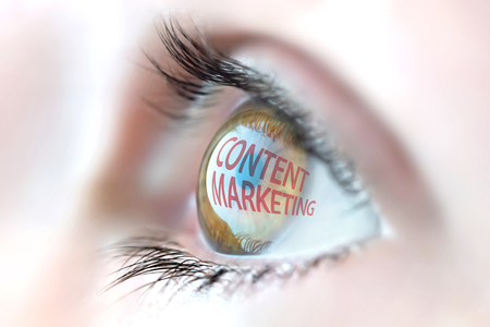 Content Marketing reflection in eye. Stock Photo