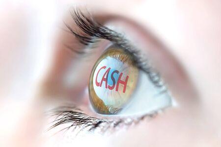 cash flow statement: Cash reflection in eye.
