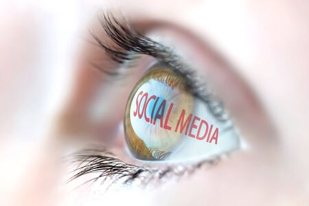 Social media reflection in eye.