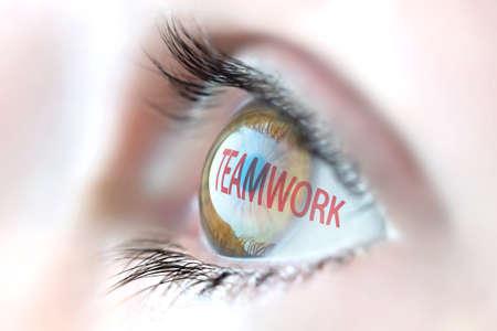 teaming: Teamwork reflection in eye.