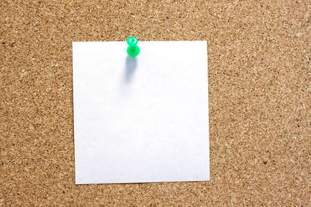 postit note: Post-it note with green pushpin on corkboard.