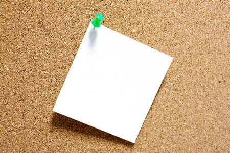 memorize: Post-it note with green pushpin on corkboard.
