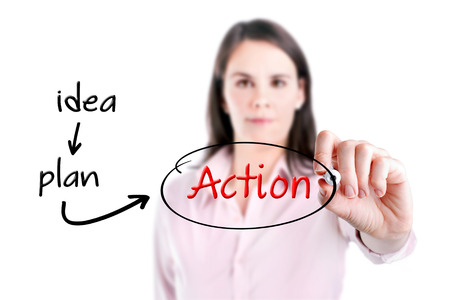 people in action: Young business woman writing business concept.