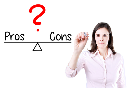 conform: Young business woman writing pros and cons compare on balance bar. Isolated on white.