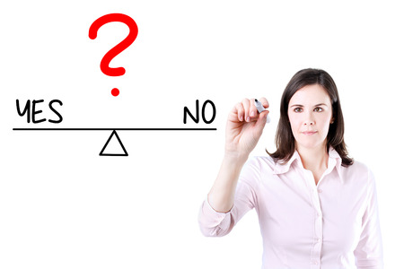 right vs wrong: Young business woman writing yes and no compare on balance bar. Isolated on white.