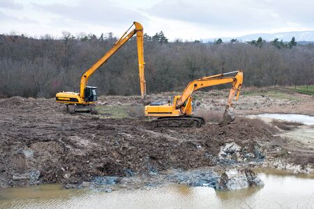 excavating: Soil pollution with restoration Excavating and Earthmoving work.