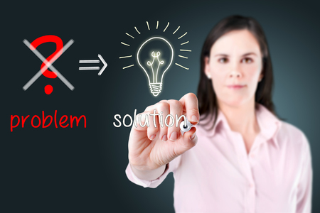 eliminate: Young business woman Eliminate problem and find solution. Stock Photo