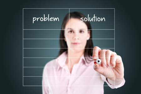 correlate: Young business woman writing problem and solution in blank list. Stock Photo